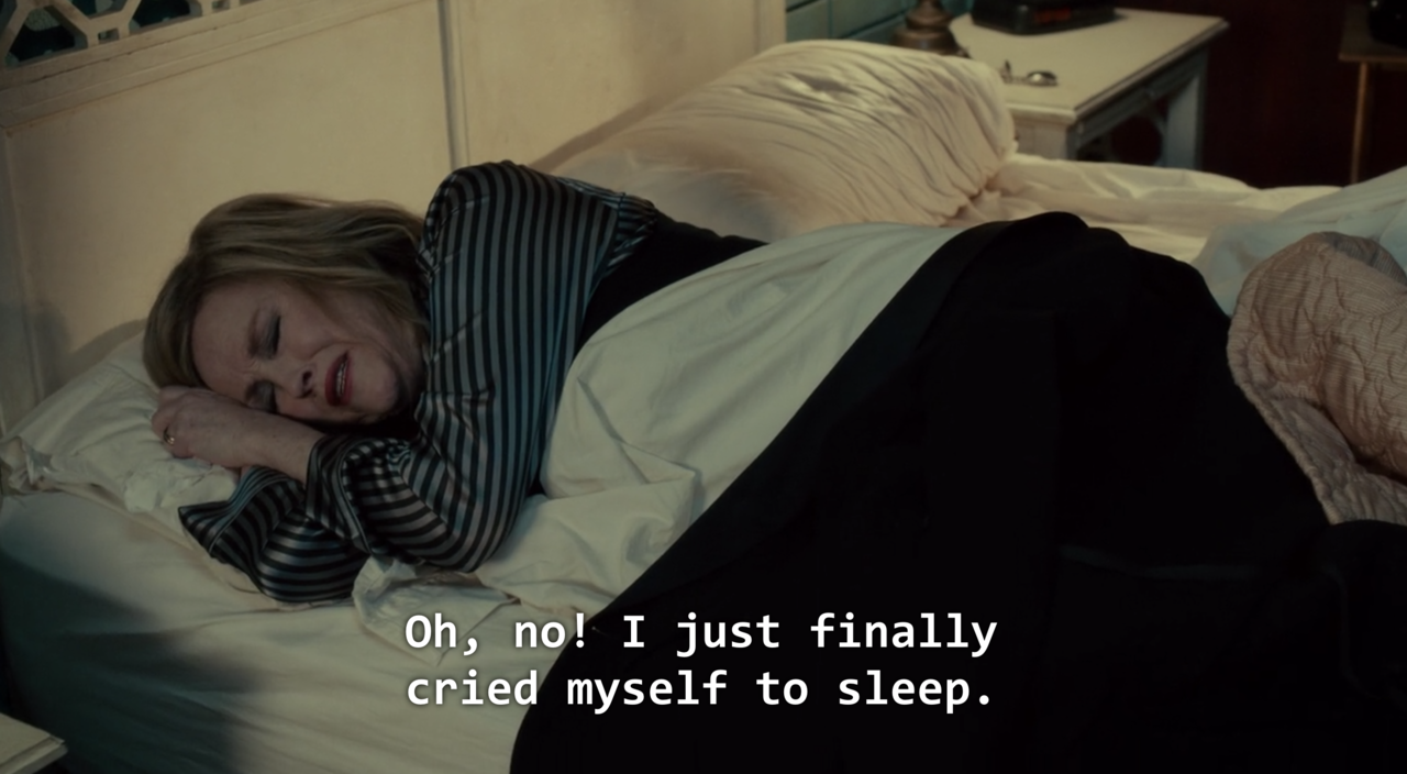 """Moira Rose played by Catherine O'Hara lies in bed. Caption reads """"Oh no! I just finally cried myself to sleep"""""""